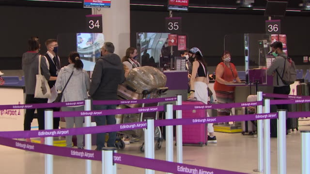 people in departures at edinburgh airport travelling to greece even though they will have to quarantine on their return due to coronavirus pandemic - aerospace stock videos & royalty-free footage