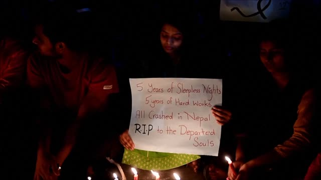 People in Dhaka hold a candlelight vigil in honour of the victims of the deadly US Bangla Airlines crash at Kathmandu's international airport the...