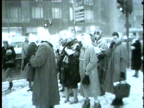 people in downtown chicago during a snow storm in 1959 - 1950 1959 stock videos & royalty-free footage
