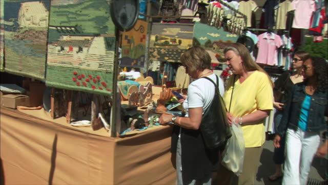 ws pov people in el rastro flea market, madrid, spain - flea market stock videos and b-roll footage