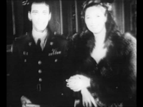 ws people in evening wear in lobby of opera house / man in us military uniform approaches with woman in dark fur coat / austrian president theodor... - österreichische kultur stock-videos und b-roll-filmmaterial