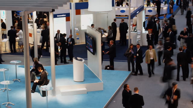t/l, ha, ms, people in exhibit hall, munich, germany - trade show stock videos and b-roll footage