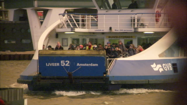 MS R/F People in ferry approaching towards terminal, pedestrian passing by / Rotterdam, Netherlands