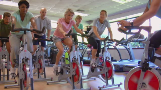ms people in fitness club spin class/ san antonio, texas - cardiovascular exercise stock videos & royalty-free footage