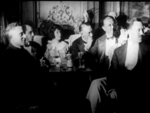 b/w 1926 people in formalwear sitting at tables smoking + drinking on cruise ship / newsreel - 1926 stock videos & royalty-free footage