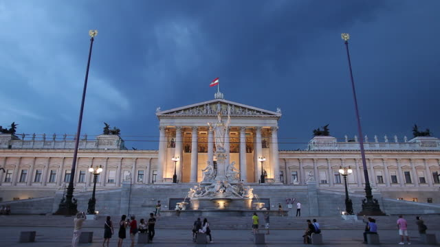 ws people in front of austrian parliament building at dusk / vienna, austria - traditionally austrian stock videos & royalty-free footage