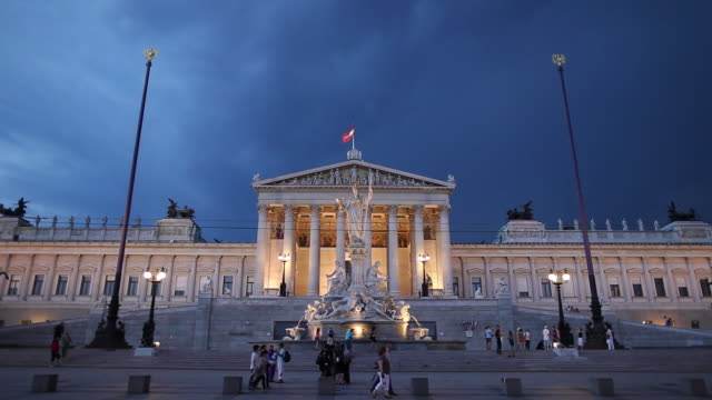 ws people in front of austrian parliament building during storm at dusk / vienna, austria - traditionally austrian stock videos & royalty-free footage