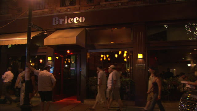 ws people in front of bricco restaurant at night, 241 hanover street, north end, italian neighborhood / boston, massachusetts, usa - italian culture stock-videos und b-roll-filmmaterial