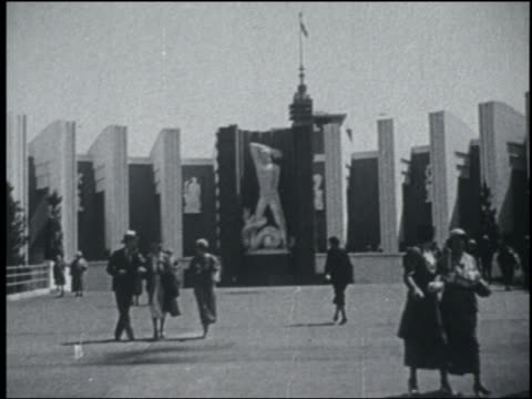 b/w 1933 people in front of curved building with statue / chicago world's fair - chicago world's fair stock videos and b-roll footage