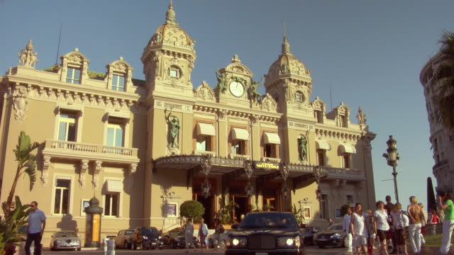 ms, people in front of entrance of monte carlo casino, monaco - monaco stock videos and b-roll footage