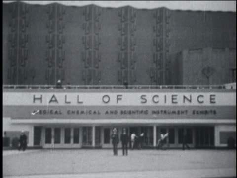 stockvideo's en b-roll-footage met people in front of hall of science building / chicago world's fair - 1933