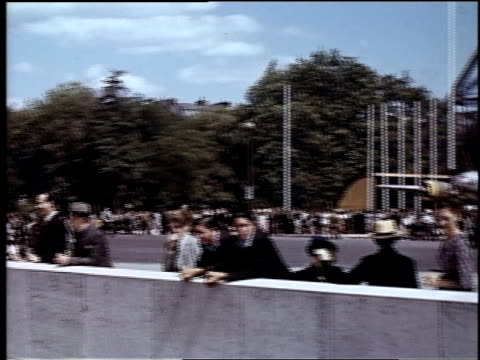 people in front of the base of the eiffel tower / paris, france - besichtigung stock-videos und b-roll-filmmaterial