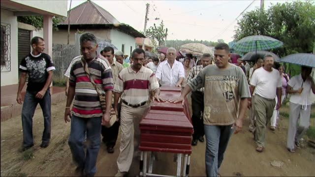 ws pan people in funeral procession with casket / colombia - funeral procession stock videos & royalty-free footage