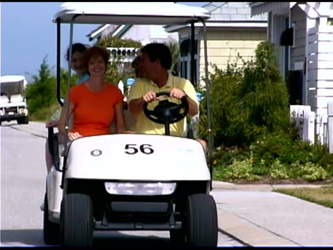 people in golf cart - golf cart stock videos and b-roll footage