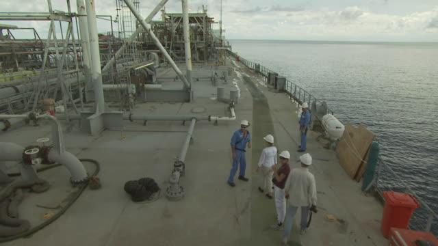 people in hard hats on oil tanker deck, australia - aboard stock videos & royalty-free footage