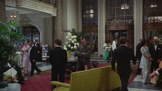 1967 ws ds people in hotel lobby / new orleans, louisiana, usa - evening gown stock videos and b-roll footage