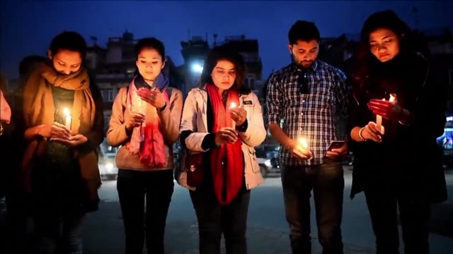 People in Kathmandu hold a candlelight vigil in honour of the victims of the deadly US Bangla Airlines crash at the city's international airport the...