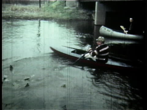 1966 ts people in kayaks and canoes on the cuyahoga river / ohio, united states - fiume cuyahoga video stock e b–roll