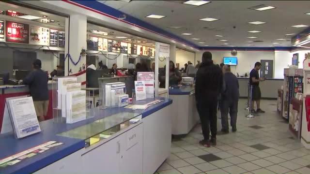 KTLA People in Line at Post Office