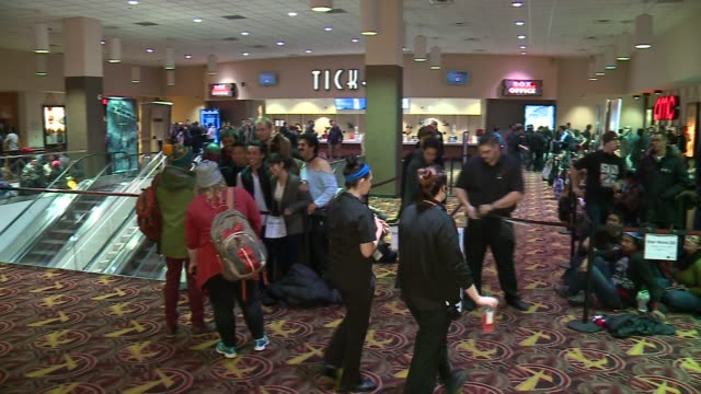 people in line to see star wars episode vii on opening night in chicago movie theater on december 17, 2015. - ticket stock videos & royalty-free footage