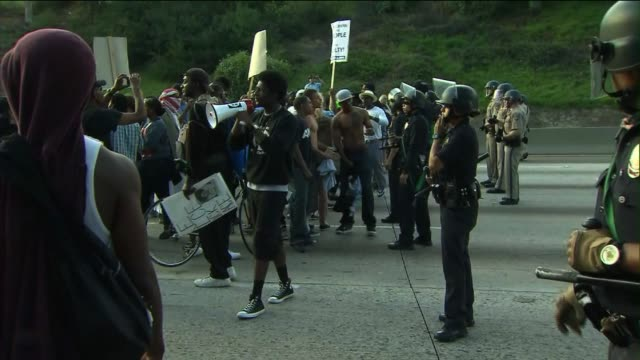 People in Los Angeles Protest After Zimmerman Verdict In Trayvon Martin Case on July 15 2013 in Los Angeles California