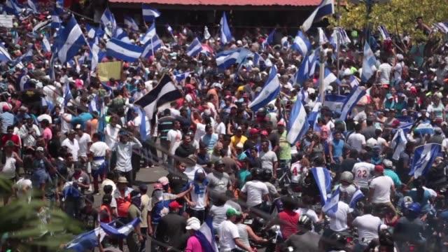people in managua nicaragua take part in a caravan of solidarity demanding justice democracy and the departure of president daniel ortega - managua stock videos & royalty-free footage