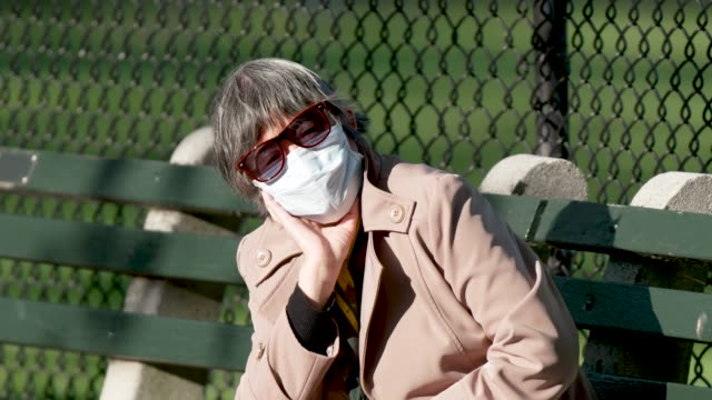 people in manhattan's central park new york city amid the outbreak of the coronavirus disease . some wore a face mask and practiced social distancing... - loneliness stock videos & royalty-free footage