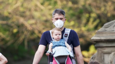 people in manhattan's central park new york city amid the outbreak of the coronavirus disease . some wore a protective face mask and practiced social... - holding stock videos & royalty-free footage