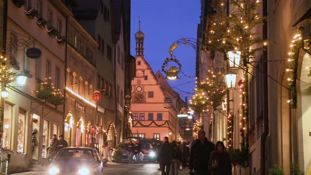 ms people in market at night/ rothenburg o.d. tauber, bavaria, germany - rothenburg stock videos and b-roll footage