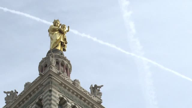people in marseille reflect on the massive fire that destroyed parts of notre dame cathedral in paris - notre dame de la garde marseille stock videos and b-roll footage