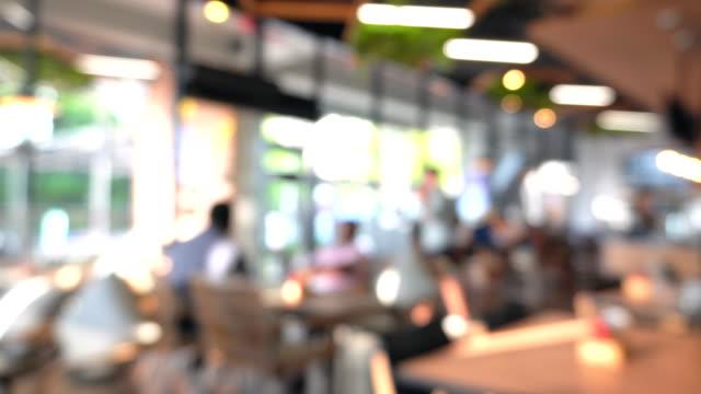 people in modern restaurant, defocused - cafe stock videos & royalty-free footage
