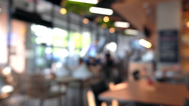 people in modern restaurant. defocused - blurred motion stock videos & royalty-free footage