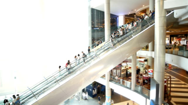 people in motion in escalators at the modern shopping mall. - shopping centre stock videos & royalty-free footage