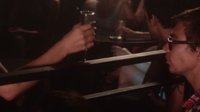ms tu zi slo mo people in nightclub texting on there phones and hanging out drinking champagne / new york city, new york, usa  - leisure activity stock videos & royalty-free footage