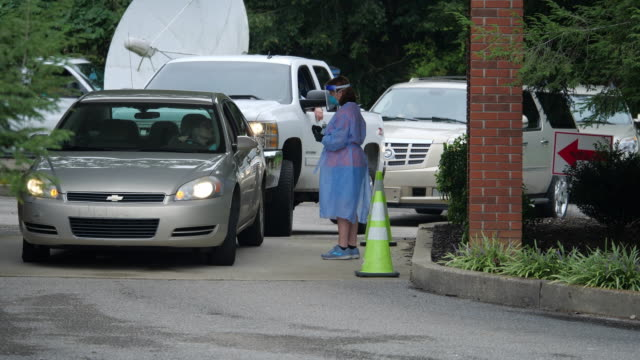 people in northwest georgia, usa come for a drive through covid-19 test during the 2020 global coronavirus pandemic, take samples from the nose. - microbiology stock videos & royalty-free footage