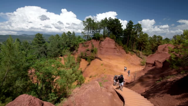 people in ocre canyon of roussillon - luberon video stock e b–roll