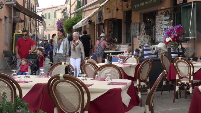 people in old town alley with street cafe - island of elba stock videos & royalty-free footage