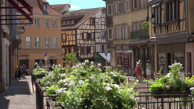 People in old town with half-timbered houses