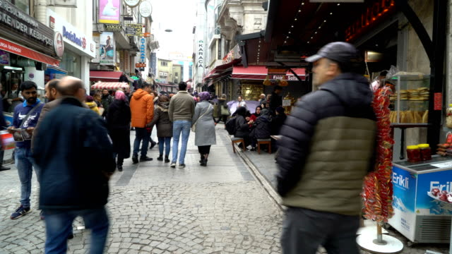 people in open street near grand bazaar in istanbul, turkey. istanbul grand bazaar is one of the world's most exciting shopping experiences. - spice bazaar stock videos & royalty-free footage