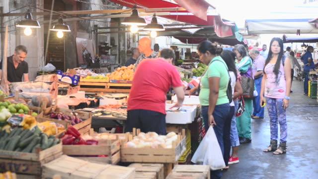 People in Ortigia Market, Syracuse (Siracusa), Sicily, Italy, Europe
