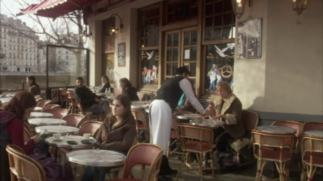 MS People in outdoors cafe, Paris, France