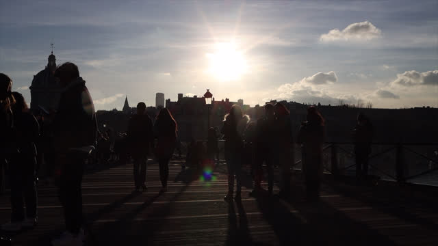 people in paris during the covid-19 pandemic on january 10, 2021 in paris, france. people walk the streets of paris on a sunny sunday in winter. pont... - infectious disease stock videos & royalty-free footage