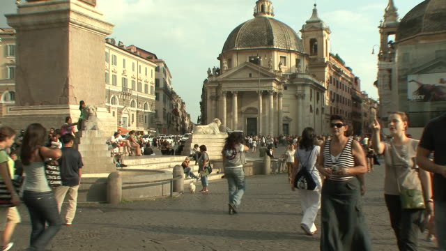 WS People in Piazza del Popolo in front of church of St Maria in Montesanto / Rome, Italy