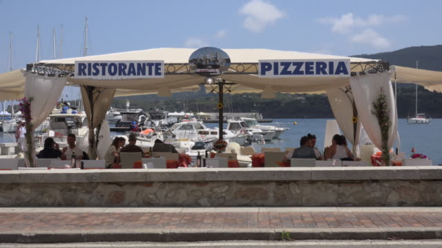 people in pizzeria at port of porto azzurro - island of elba stock videos & royalty-free footage