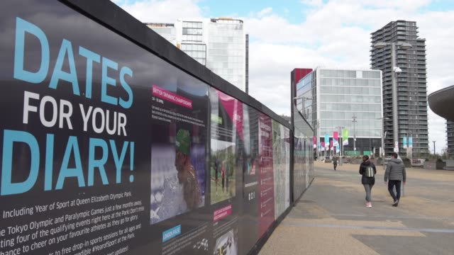 """people in protective surgical face masks walk past a billboard sign entitled """"dates for your diary"""" that lists future events at the queen elizabeth... - diary stock videos & royalty-free footage"""