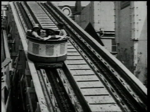 1918 tu people in roller coaster going up hill / coney island, brooklyn, new york, united states - 1918 stock videos & royalty-free footage