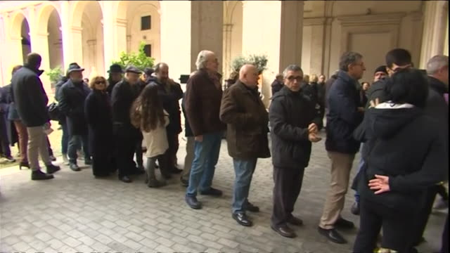 People in Rome queueing to vote in the Italian elections