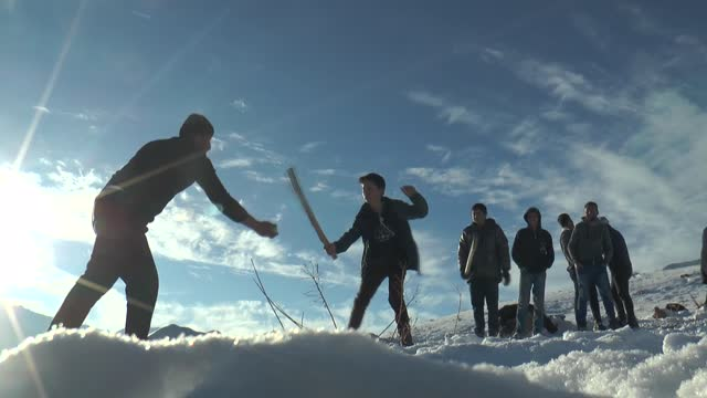 people in rural neighborhoods of eastern turkey, which is mostly covered in snow in recent weeks, have been enjoying the snowy weather by playing... - only young men stock videos & royalty-free footage