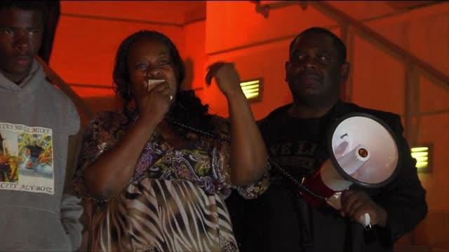 people in sacramento protest after zimmerman verdict in trayvon martin case on july 15 2013 in sacramento california - 評決点の映像素材/bロール