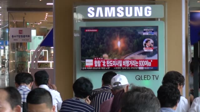 people in seoul react to north korea's ballistic missile launch which comes days after seoul's new leader moon jae in and trump focused on the... - threats stock videos and b-roll footage
